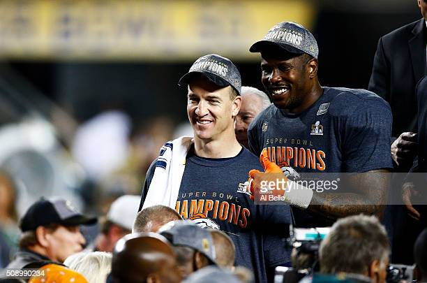 Peyton Manning and Von Miller of the Denver Broncos celebrate after defeating the Carolina Panthers during Super Bowl 50 at Levi's Stadium on...