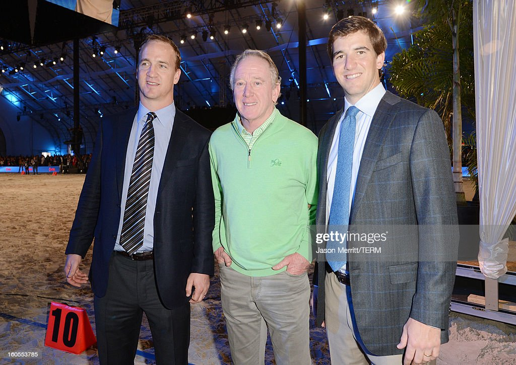Peyton Manning, Archie Manning, and Eli Manning attend DIRECTV'S Seventh Annual Celebrity Beach Bowl at DTV SuperFan Stadium at Mardi Gras World on February 2, 2013 in New Orleans, Louisiana.