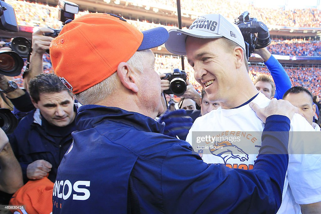 <a gi-track='captionPersonalityLinkClicked' href=/galleries/search?phrase=Peyton+Manning&family=editorial&specificpeople=184524 ng-click='$event.stopPropagation()'>Peyton Manning</a> #18 embraces head coach <a gi-track='captionPersonalityLinkClicked' href=/galleries/search?phrase=John+Fox+-+Trainer&family=editorial&specificpeople=206657 ng-click='$event.stopPropagation()'>John Fox</a> of the Denver Broncos after they defeated the New England Patriots 26 to 16 during the AFC Championship game at Sports Authority Field at Mile High on January 19, 2014 in Denver, Colorado.