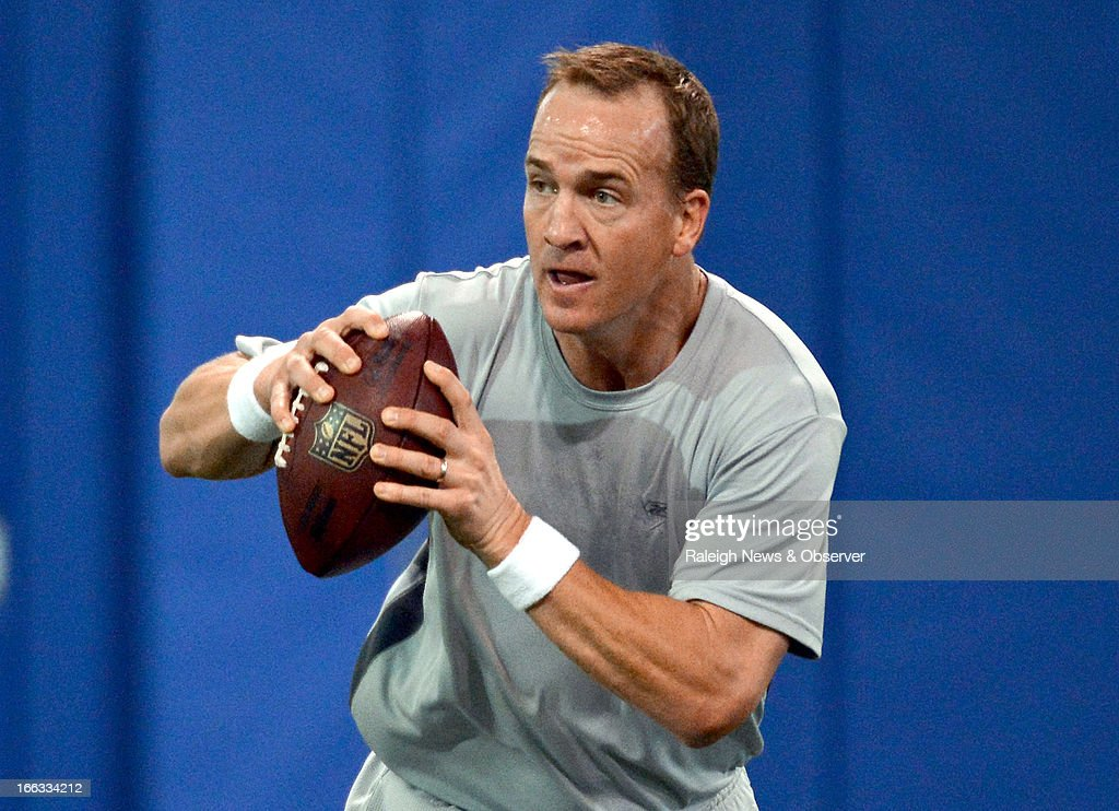 Peyton Manning goes to pass during a workout at Duke's Pascal Field House in Durham, North Carolina, Thursday, April 11, 2013.