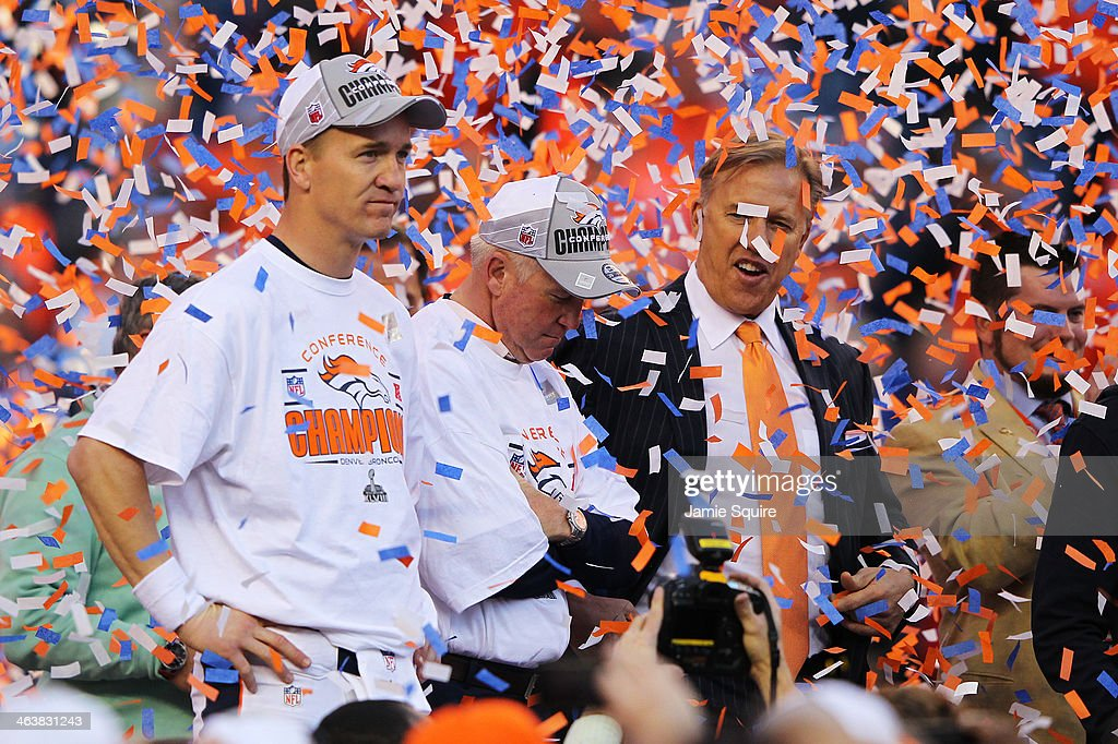 Peyton Manning head coach John Fox and John Elway executive vice president of football operations for the Denver Broncos celebrate after they...