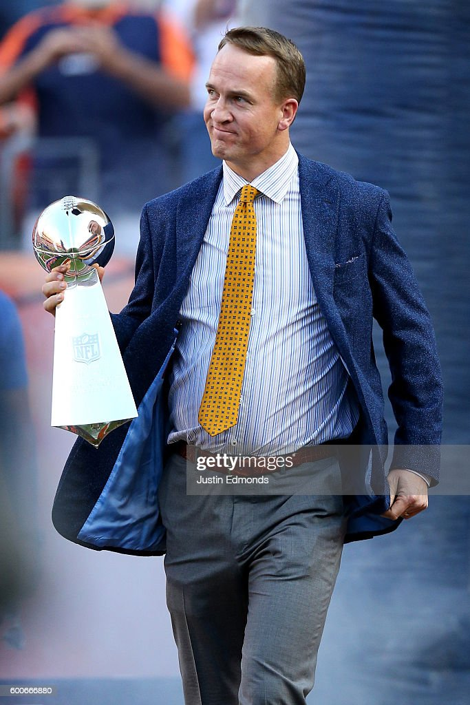 Peyton Manning holds the Lombardi Trophy to celebrate the Denver Broncos in win Super Bowl 50 at Sports Authority Field at Mile High before taking on the Carolina Panthers on September 8, 2016 in Denver, Colorado.