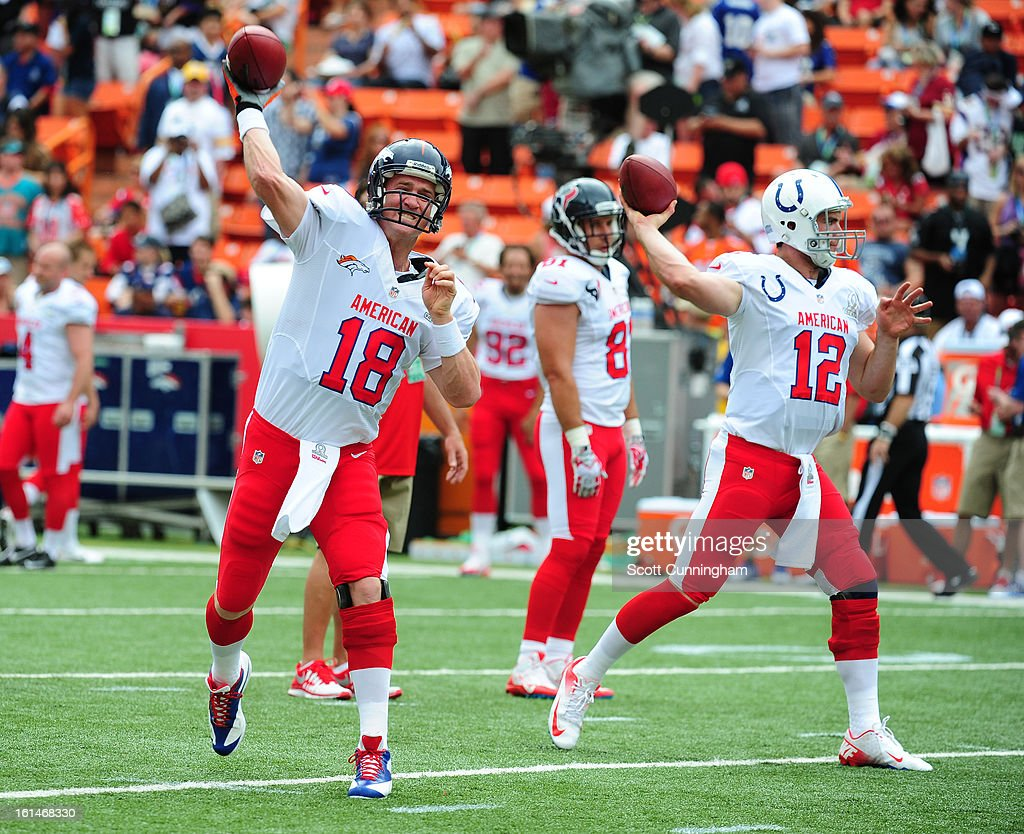 Peyton Manning #18 of the Denver Broncos and Andrew Luck #12 of the Indianapolis Colts warm up before the 2013 Pro Bowl against the National Football Conference team at Aloha Stadium on January 27, 2013 in Honolulu, Hawaii.