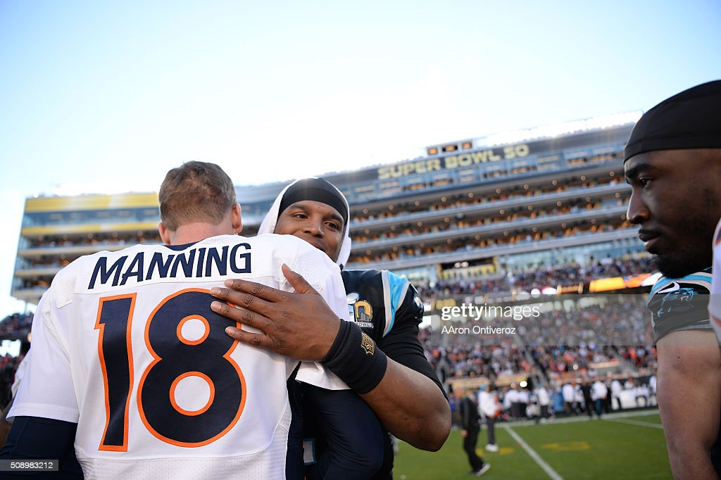 <a gi-track='captionPersonalityLinkClicked' href=/galleries/search?phrase=Peyton+Manning&family=editorial&specificpeople=184524 ng-click='$event.stopPropagation()'>Peyton Manning</a> (18) of the Denver Broncos and <a gi-track='captionPersonalityLinkClicked' href=/galleries/search?phrase=Cam+Newton+-+Amerikansk+fotbollsspelare+-+Quarterback&family=editorial&specificpeople=4516761 ng-click='$event.stopPropagation()'>Cam Newton</a> (1) of the Carolina Panthers hug at the coin toss before the game. The Denver Broncos played the Carolina Panthers in Super Bowl 50 at Levi's Stadium in Santa Clara, Calif. on February 7, 2016.