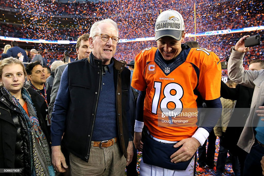 <a gi-track='captionPersonalityLinkClicked' href=/galleries/search?phrase=Peyton+Manning&family=editorial&specificpeople=184524 ng-click='$event.stopPropagation()'>Peyton Manning</a> #18 of the Denver Broncos and father <a gi-track='captionPersonalityLinkClicked' href=/galleries/search?phrase=Archie+Manning&family=editorial&specificpeople=453294 ng-click='$event.stopPropagation()'>Archie Manning</a> walk off the field after defeating the New England Patriots in the AFC Championship game at Sports Authority Field at Mile High on January 24, 2016 in Denver, Colorado. The Broncos defeated the Patriots 20-18.
