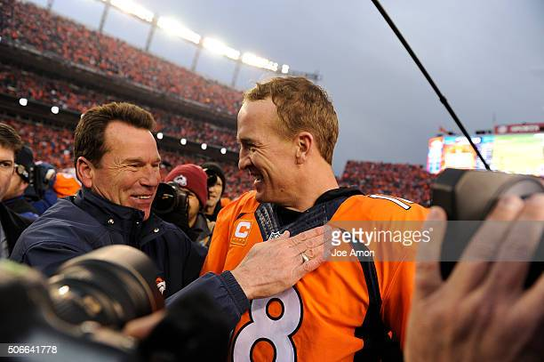 Peyton Manning of the Denver Broncos and head coach Gary Kubiak of the Denver Broncos meet on the field after the game The Denver Broncos played the...