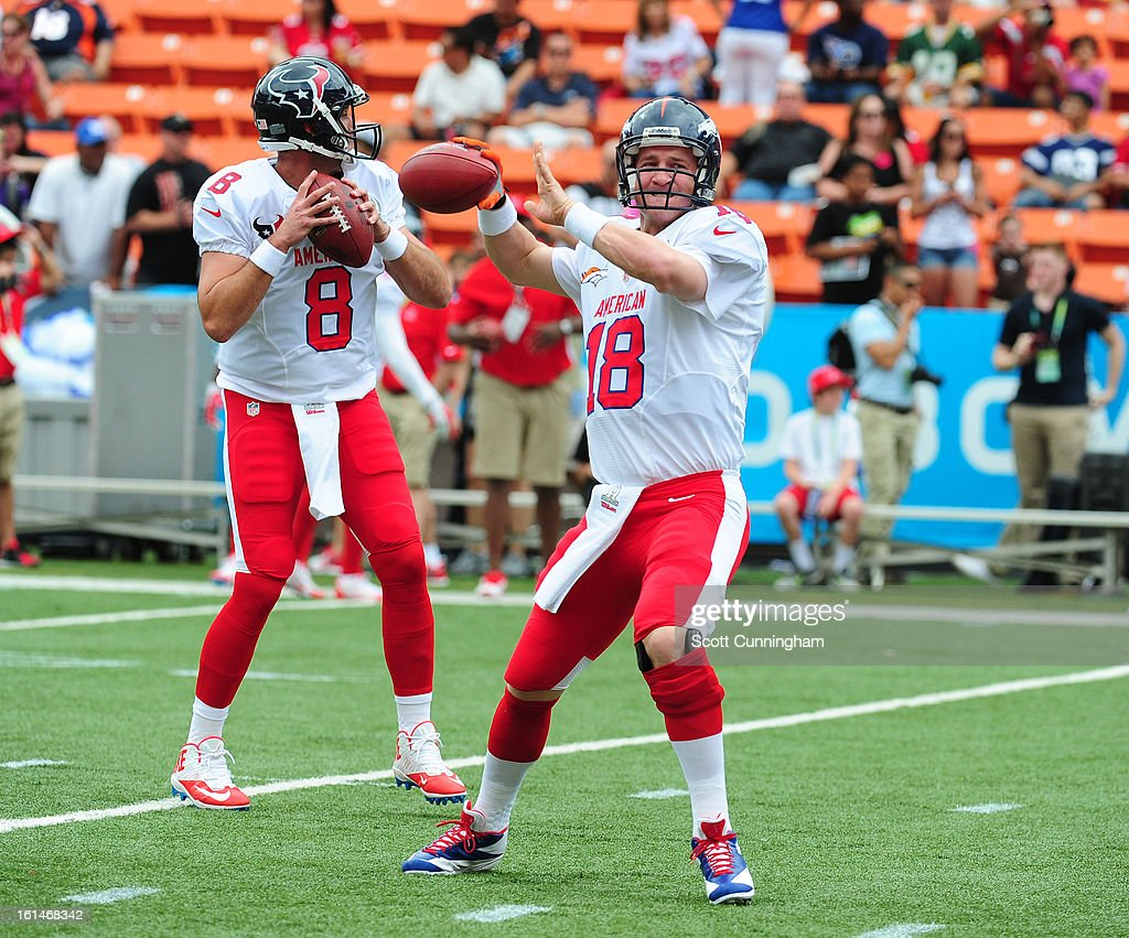 Peyton Manning #18 of the Denver Broncos and Matt Schaub #8 of the Houston Texans warm up before the 2013 Pro Bowl against the National Football Conference team at Aloha Stadium on January 27, 2013 in Honolulu, Hawaii.