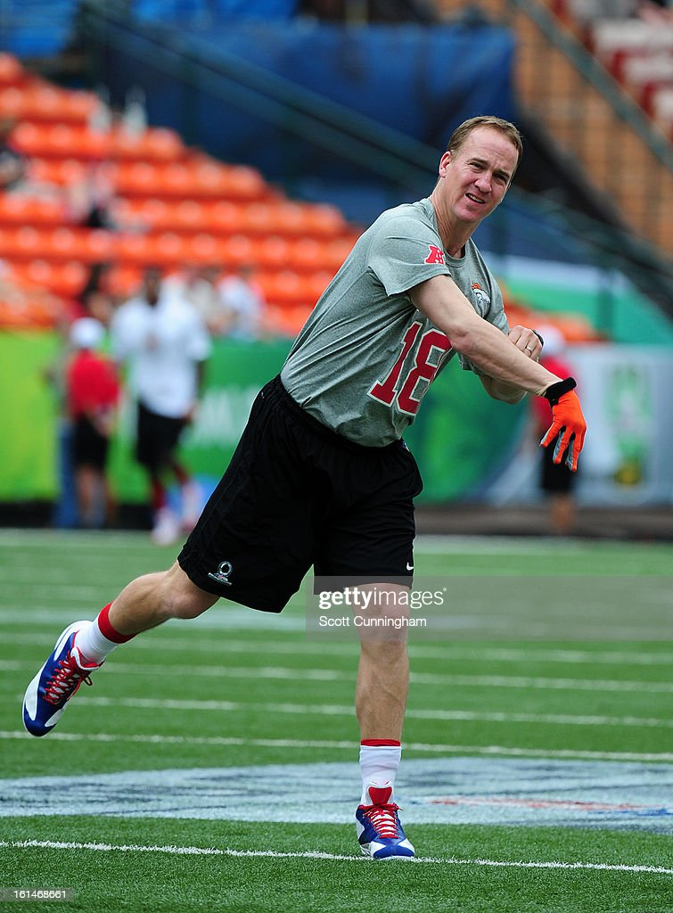 Peyton Manning #18 of the Denver Broncos and the AFC and the AFC warms up before the 2013 Pro Bowl against the NFC team at Aloha Stadium on January 27, 2013 in Honolulu, Hawaii.