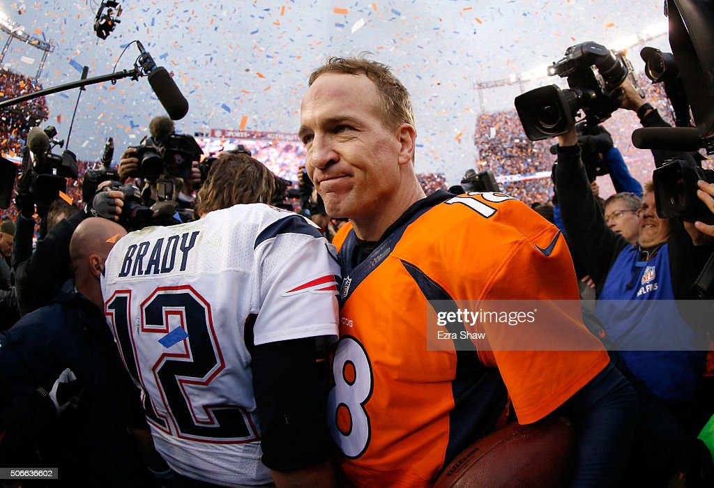 Peyton Manning of the Denver Broncos and Tom Brady of the New England Patriots speak after the AFC Championship game at Sports Authority Field at...