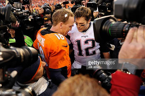Peyton Manning of the Denver Broncos and Tom Brady of the New England Patriots meet on the field after the game The Denver Broncos played the New...