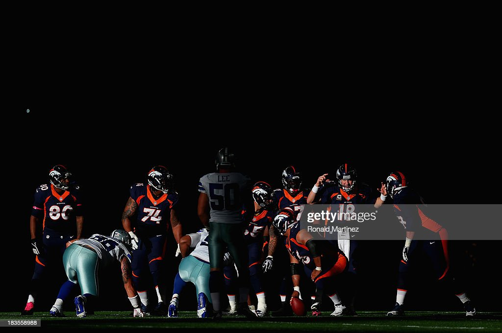 <a gi-track='captionPersonalityLinkClicked' href=/galleries/search?phrase=Peyton+Manning&family=editorial&specificpeople=184524 ng-click='$event.stopPropagation()'>Peyton Manning</a> #18 of the Denver Broncos calls a play against the Dallas Cowboys in the fourth quarter at AT&T Stadium on October 6, 2013 in Arlington, Texas.