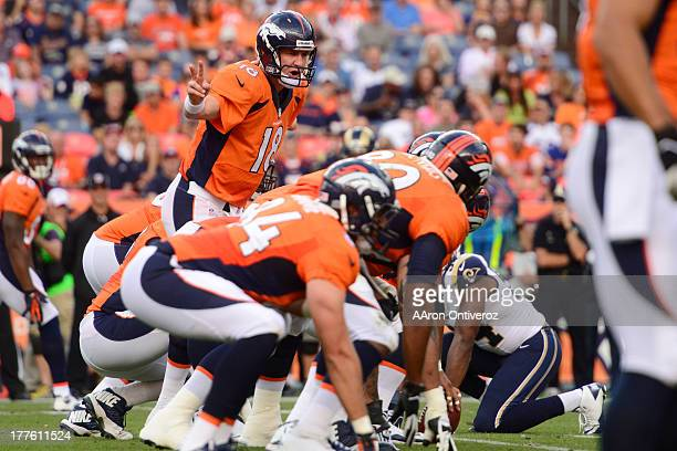 Peyton Manning of the Denver Broncos calls out a play under center against the St Louis Rams during the first half of action of an NFL preseason game...