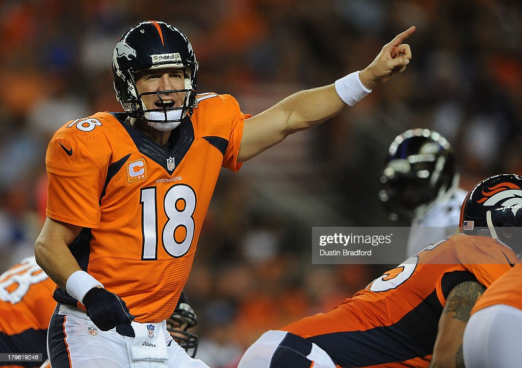 Peyton Manning #18 of the Denver Broncos calls out to his teammates behind center against the Baltimore Ravens in the first half during the game at Sports Authority Field at Mile High on September 5, 2013 in Denver Colorado.