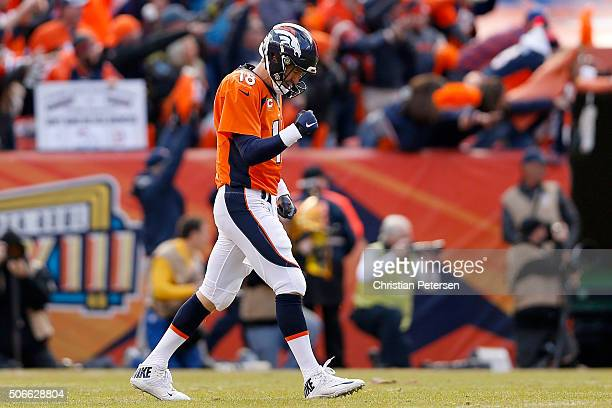 Peyton Manning of the Denver Broncos celebrates after passing for a 12yard touchdown in the second quarter against the New England Patriots in the...