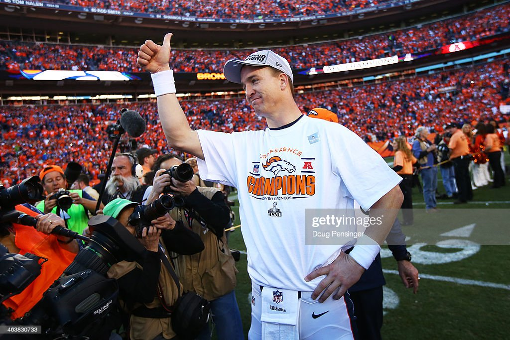 <a gi-track='captionPersonalityLinkClicked' href=/galleries/search?phrase=Peyton+Manning&family=editorial&specificpeople=184524 ng-click='$event.stopPropagation()'>Peyton Manning</a> #18 of the Denver Broncos celebrates after they defeated the New England Patriots 26 to 16 during the AFC Championship game at Sports Authority Field at Mile High on January 19, 2014 in Denver, Colorado.