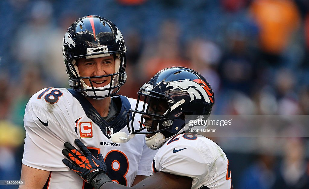 Peyton Manning #18 of the Denver Broncos celebrates with Montee Ball #28 after Manning set the NFL record for touchdown passes in a season with 51, in a 37-13 defeat of the Houston Texans at Reliant Stadium on December 22, 2013 in Houston, Texas.