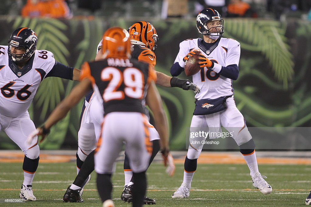 Peyton Manning #18 of the Denver Broncos drops back to pass during the game against the Cincinnati Bengals at Paul Brown Stadium on December 22, 2014 in Cincinnati, Ohio. The Bengals defeated the Broncos 37-28.
