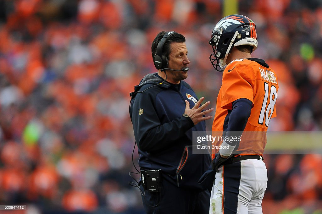 <a gi-track='captionPersonalityLinkClicked' href=/galleries/search?phrase=Peyton+Manning&family=editorial&specificpeople=184524 ng-click='$event.stopPropagation()'>Peyton Manning</a> #18 of the Denver Broncos has a word with quarterbacks coach <a gi-track='captionPersonalityLinkClicked' href=/galleries/search?phrase=Greg+Knapp&family=editorial&specificpeople=750404 ng-click='$event.stopPropagation()'>Greg Knapp</a> in the AFC Championship game against the New England Patriots at Sports Authority Field at Mile High on January 24, 2016 in Denver, Colorado.