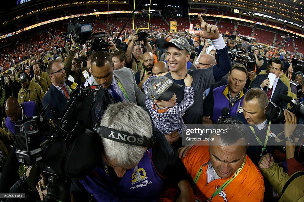 <a gi-track='captionPersonalityLinkClicked' href=/galleries/search?phrase=Peyton+Manning&family=editorial&specificpeople=184524 ng-click='$event.stopPropagation()'>Peyton Manning</a> #18 of the Denver Broncos holds his son Marshall after the Denver Broncos defeated the Carolina Panthers with a score of 24 to 10 to win Super Bowl 50 at Levi's Stadium on February 7, 2016 in Santa Clara, California.