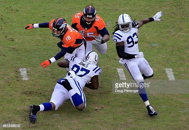 Peyton Manning of the Denver Broncos is tackled after the pass by Arthur Jones of the Indianapolis Colts during a 2015 AFC Divisional Playoff game at...