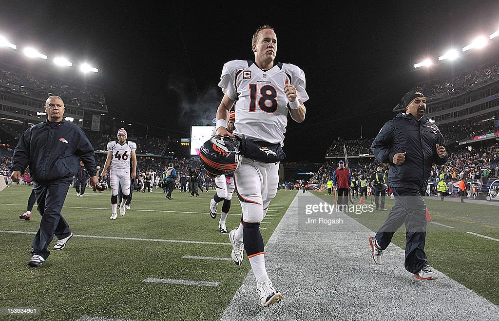 Peyton Manning #18 of the Denver Broncos leaves the field after a loss to the New England Patriots at Gillette Stadium on October 7, 2012 in Foxboro, Massachusetts.