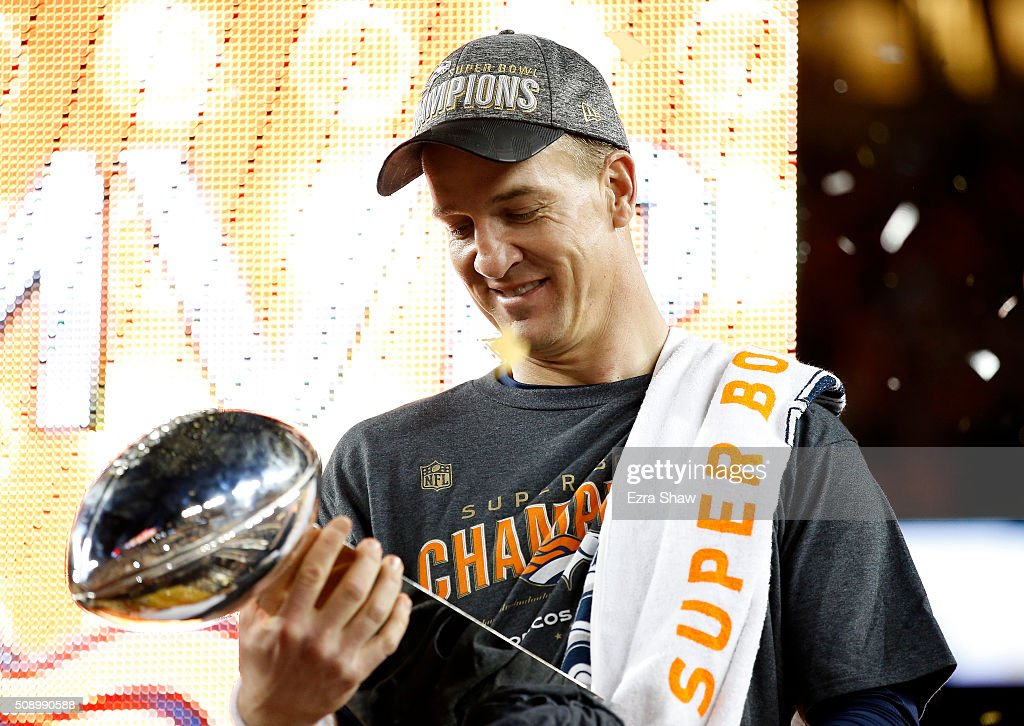 Peyton Manning #18 of the Denver Broncos looks at the Vince Lombardi Trophy after Super Bowl 50 at Levi's Stadium on February 7, 2016 in Santa Clara, California. The Broncos defeated the Panthers 24-10.