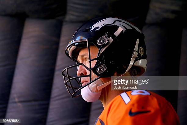 Peyton Manning of the Denver Broncos looks on from the tunnel before the AFC Championship game against the New England Patriots at Sports Authority...