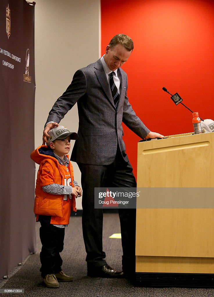 <a gi-track='captionPersonalityLinkClicked' href=/galleries/search?phrase=Peyton+Manning&family=editorial&specificpeople=184524 ng-click='$event.stopPropagation()'>Peyton Manning</a> #18 of the Denver Broncos looks on with his son, <a gi-track='captionPersonalityLinkClicked' href=/galleries/search?phrase=Marshall+Manning&family=editorial&specificpeople=12446206 ng-click='$event.stopPropagation()'>Marshall Manning</a>, during a post game press conference after defeating the New England Patriots in the AFC Championship game at Sports Authority Field at Mile High on January 24, 2016 in Denver, Colorado. The Broncos defeated the Patriots 20-18.