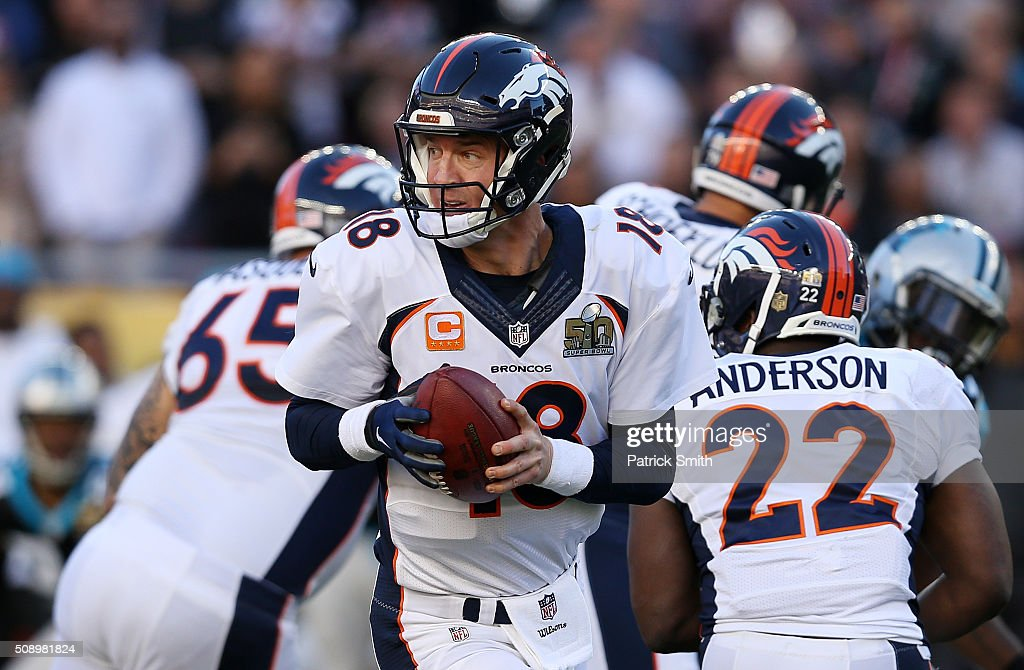 <a gi-track='captionPersonalityLinkClicked' href=/galleries/search?phrase=Peyton+Manning&family=editorial&specificpeople=184524 ng-click='$event.stopPropagation()'>Peyton Manning</a> #18 of the Denver Broncos looks to hand the ball off in the first quarter against the Carolina Panthers during Super Bowl 50 at Levi's Stadium on February 7, 2016 in Santa Clara, California.