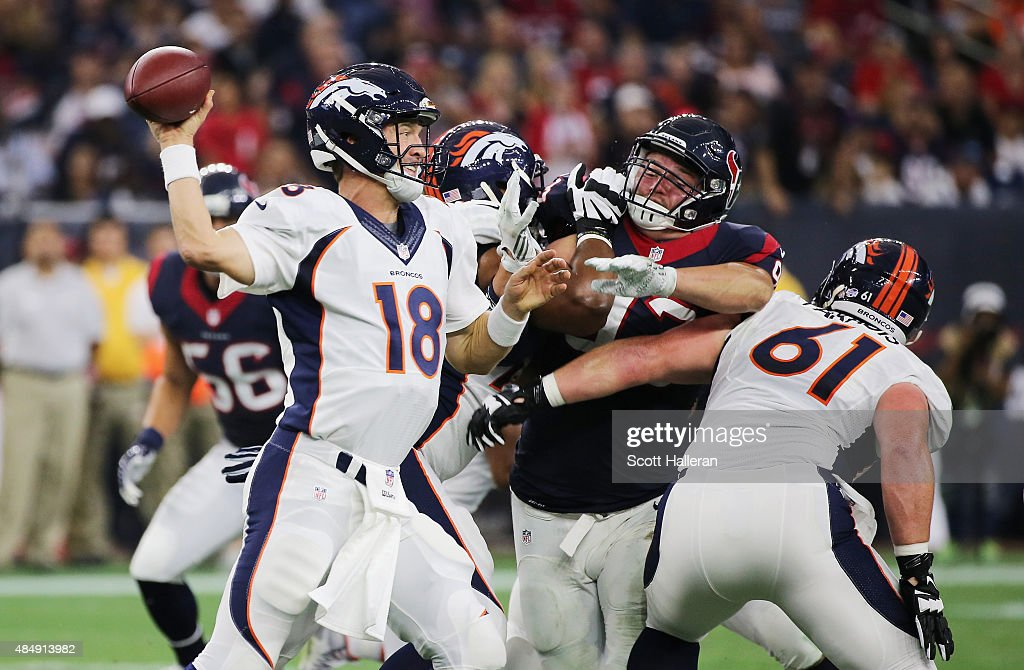Peyton Manning #18 of the Denver Broncos looks to pass in the first half of their game against the Houston Texans at NRG Stadium on August 22, 2015 in Houston, Texas.