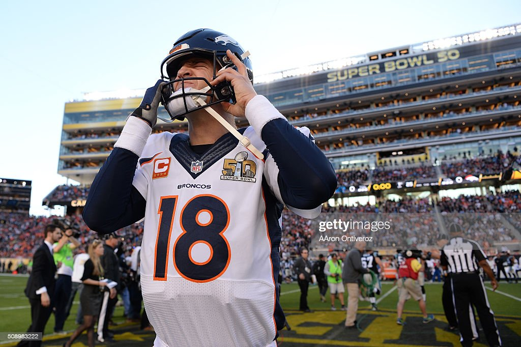 <a gi-track='captionPersonalityLinkClicked' href=/galleries/search?phrase=Peyton+Manning&family=editorial&specificpeople=184524 ng-click='$event.stopPropagation()'>Peyton Manning</a> (18) of the Denver Broncos pulls his helmet on after the coin toss. The Denver Broncos played the Carolina Panthers in Super Bowl 50 at Levi's Stadium in Santa Clara, Calif. on February 7, 2016.