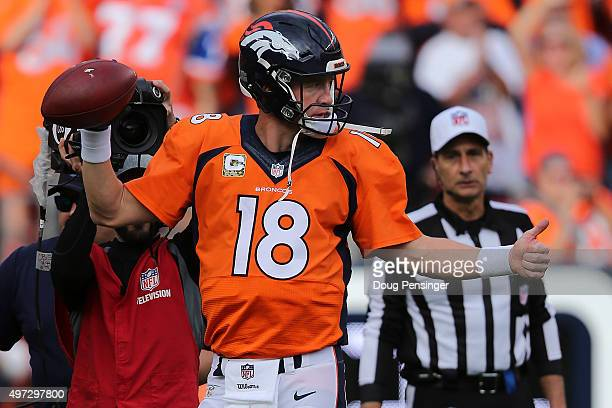 Peyton Manning of the Denver Broncos reacts as he sets the NFL career passing yards record with a four yard completion to Ronnie Hillman of the...