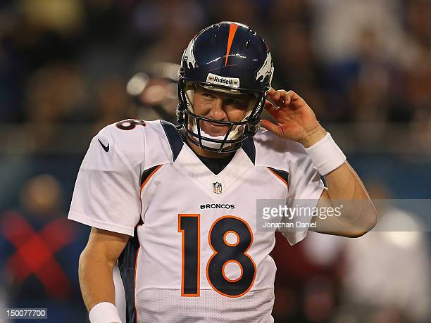 Peyton Manning of the Denver Broncos reacts as he walks off of the field after throwing an interception against the Chicago Bears during a preseason...