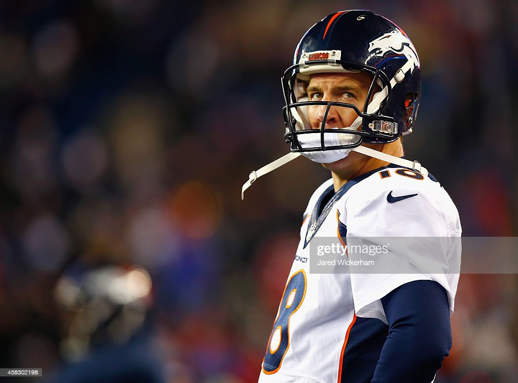 Peyton Manning #18 of the Denver Broncos reacts during the fourth quarter against the New England Patriots at Gillette Stadium on November 2, 2014 in Foxboro, Massachusetts.