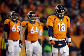 Peyton Manning of the Denver Broncos reacts in the fourth quarter against the Indianapolis Colts during a 2015 AFC Divisional Playoff game at Sports...