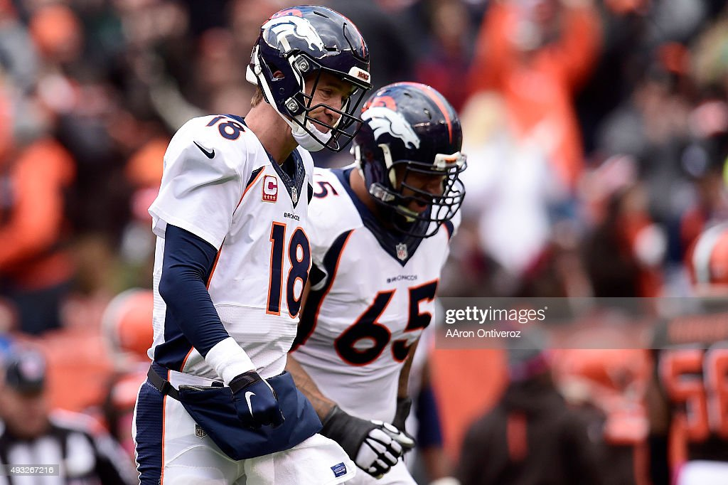 Peyton Manning of the Denver Broncos reacts to throwing an interception to Karlos Dansby of the Cleveland Browns during the first half of action at...