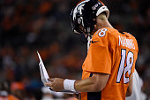 Peyton Manning of the Denver Broncos reviews plays on the sidelines against the San Francisco 49ers during the second half of the Broncos' 1912 win...