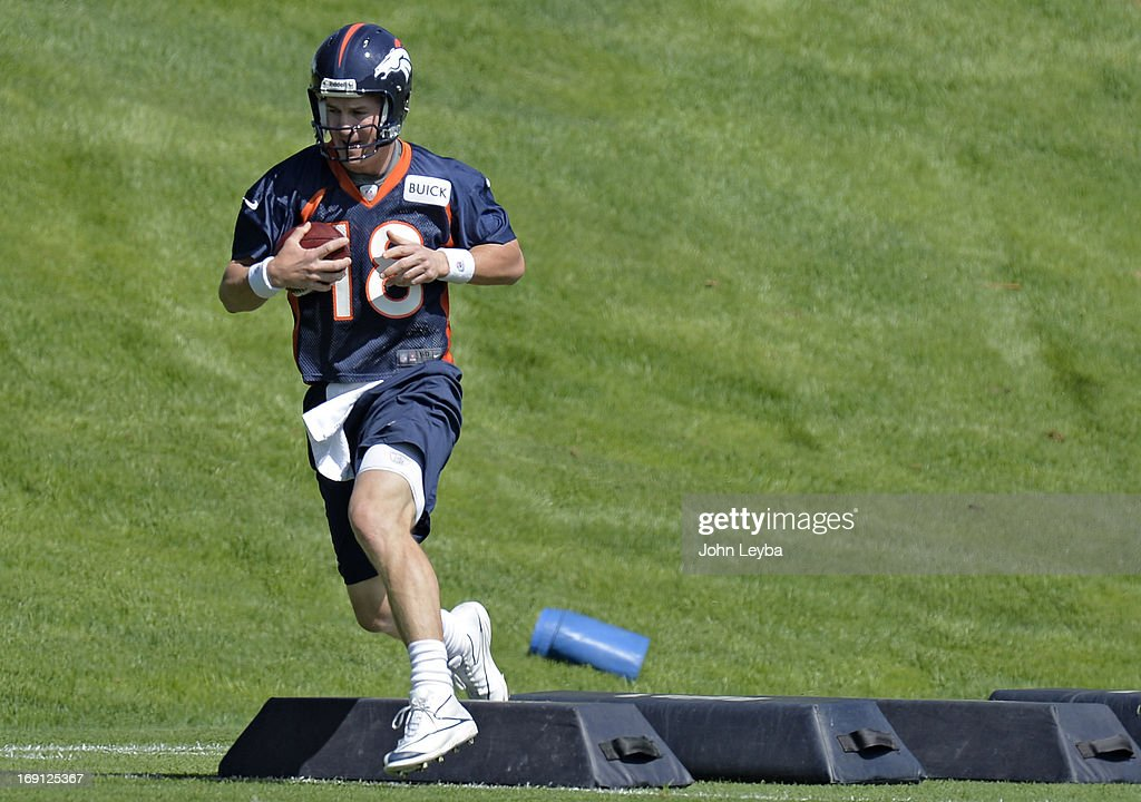 ENGLEWOOD, CO. - Peyton Manning (18) of the Denver Broncos runs through drills during the teams OTAs May 20, 2013 at Dove Valley. All offseason training activities (OTAs) are voluntary until the mandatory minicamp June 11-13.