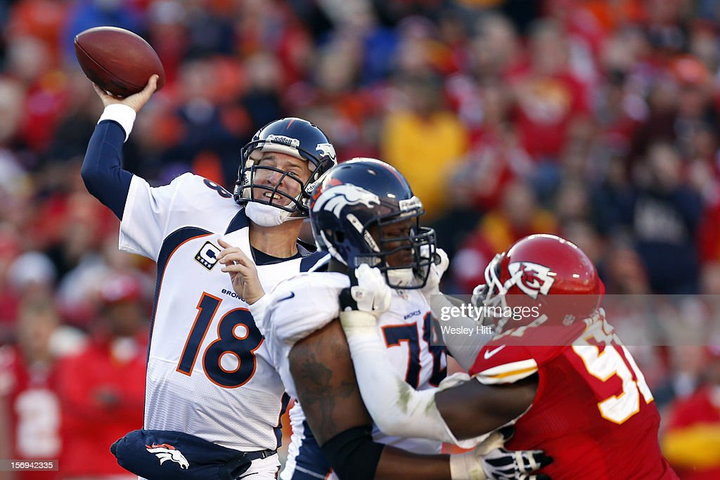 Peyton Manning #18 of the Denver Broncos throws a pass against the Kansas City Chiefs at Arrowhead Stadium on November 25, 2012 in Kansas City, Missouri. The Broncos defeated the Chiefs 17-9.