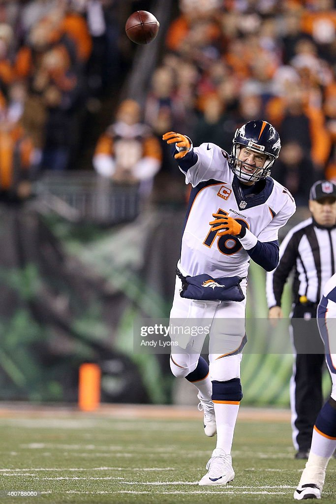 Peyton Manning #18 of the Denver Broncos throws a pass during the first quarter of the game against the Cincinnati Bengals at Paul Brown Stadium on December 22, 2014 in Cincinnati, Ohio.
