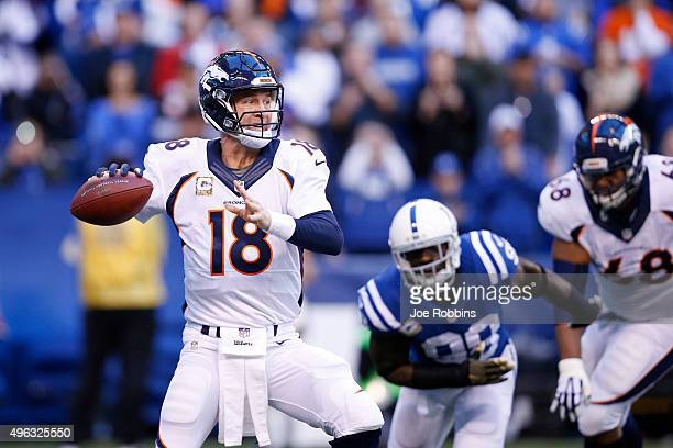 Peyton Manning of the Denver Broncos throws a pass in the first quarter of the game against the Indianapolis Colts at Lucas Oil Stadium on November 8...