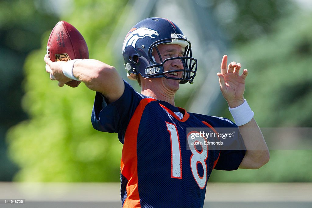 Peyton Manning #18 of the Denver Broncos throws during organized team activities at Dove Valley on May 21, 2012 in Englewood, Colorado.