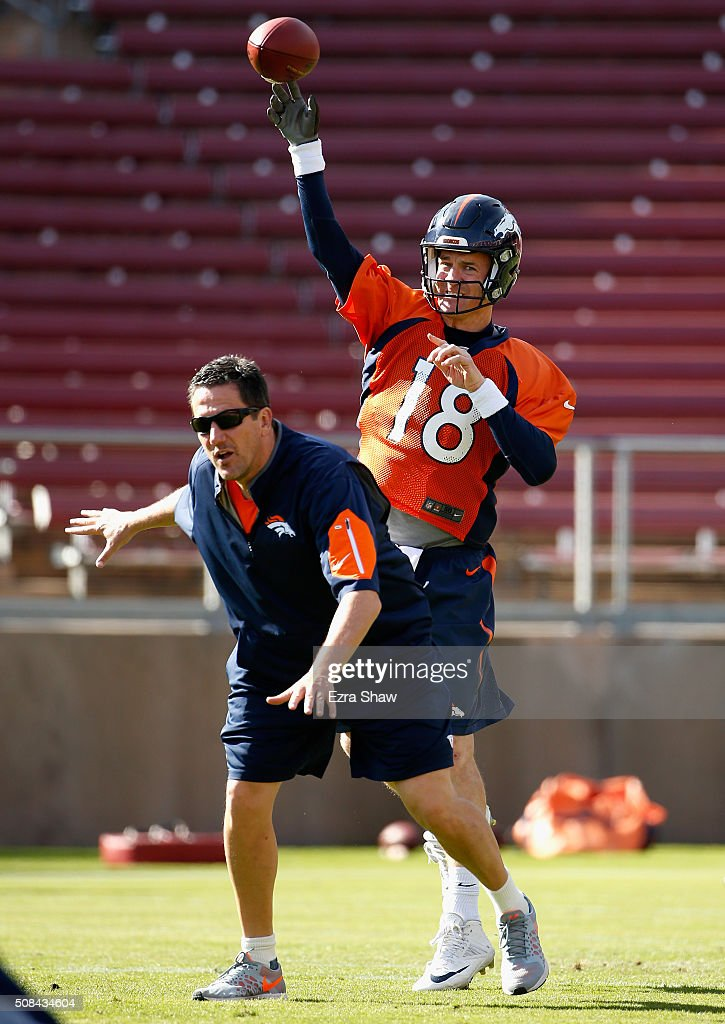 <a gi-track='captionPersonalityLinkClicked' href=/galleries/search?phrase=Peyton+Manning&family=editorial&specificpeople=184524 ng-click='$event.stopPropagation()'>Peyton Manning</a> #18 of the Denver Broncos throws the ball over quarterback coach <a gi-track='captionPersonalityLinkClicked' href=/galleries/search?phrase=Greg+Knapp&family=editorial&specificpeople=750404 ng-click='$event.stopPropagation()'>Greg Knapp</a> during practice at Stanford Stadium on February 4, 2016 in Stanford, California. The Broncos will play the Carolina Panthers in Super Bowl 50 on February 7, 2016.