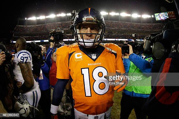 Peyton Manning of the Denver Broncos walks off the field after losing 2413 to the Indianapolis Colts in a 2015 AFC Divisional Playoff game at Sports...