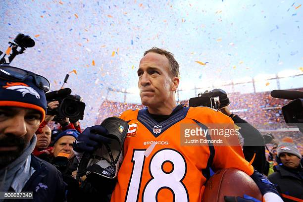 Peyton Manning of the Denver Broncos walks off the field after defeating the New England Patriots in the AFC Championship game at Sports Authority...