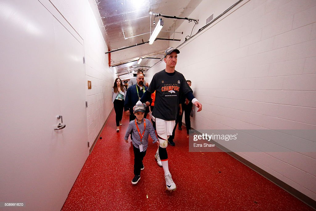 <a gi-track='captionPersonalityLinkClicked' href=/galleries/search?phrase=Peyton+Manning&family=editorial&specificpeople=184524 ng-click='$event.stopPropagation()'>Peyton Manning</a> #18 of the Denver Broncos walks with his son <a gi-track='captionPersonalityLinkClicked' href=/galleries/search?phrase=Marshall+Manning&family=editorial&specificpeople=12446206 ng-click='$event.stopPropagation()'>Marshall Manning</a> after defeating the Carolina Panthers during Super Bowl 50 at Levi's Stadium on February 7, 2016 in Santa Clara, California. The Broncos defeated the Panthers 24-10.