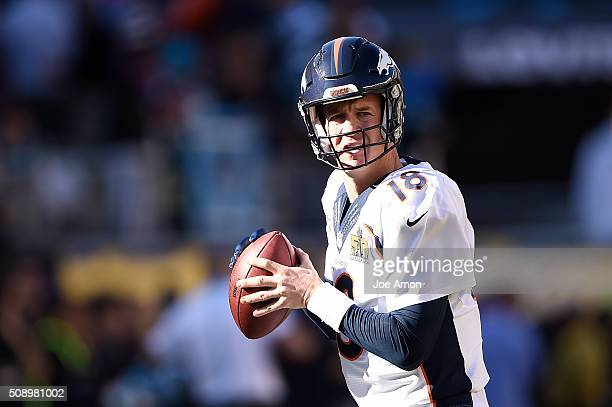 Peyton Manning of the Denver Broncos warms up before the game The Denver Broncos played the Carolina Panthers in Super Bowl 50 at Levi's Stadium in...