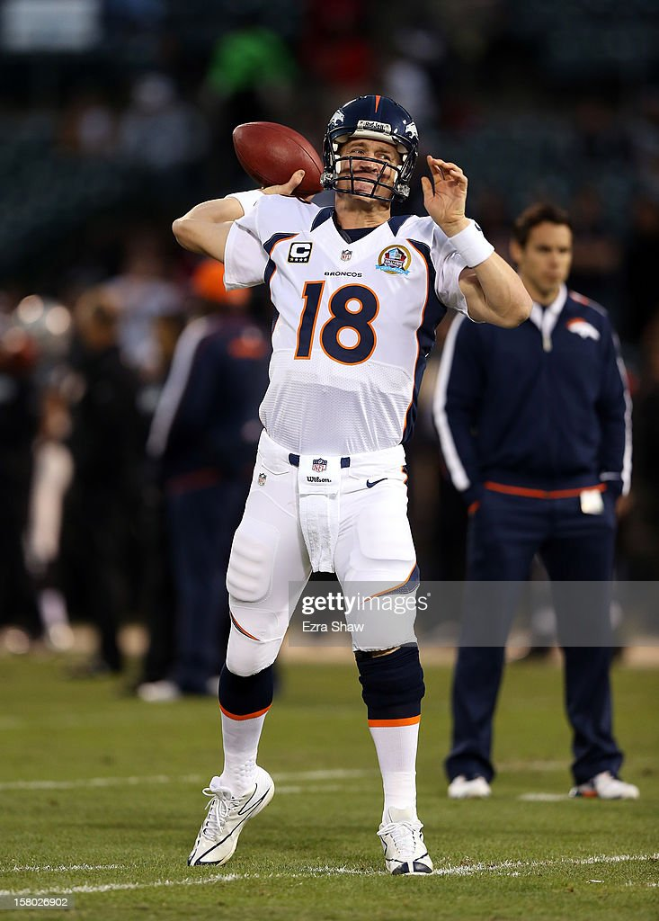 <a gi-track='captionPersonalityLinkClicked' href=/galleries/search?phrase=Peyton+Manning&family=editorial&specificpeople=184524 ng-click='$event.stopPropagation()'>Peyton Manning</a> #18 of the Denver Broncos warms up before their game against the Oakland Raiders at O.co Coliseum on December 6, 2012 in Oakland, California.