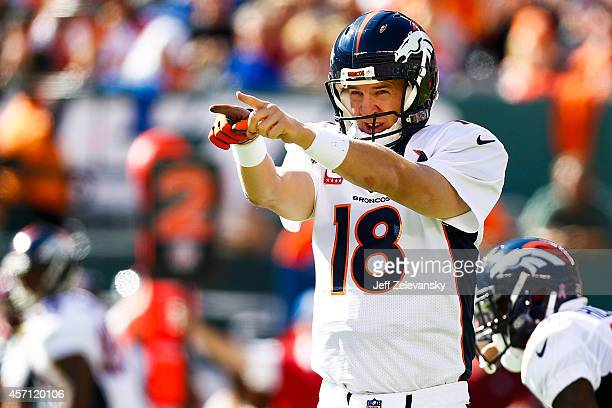 Peyton Manning of the Denver Broncos yells to teammates in the second quarter during a game against the New York Jets at MetLife Stadium on October...