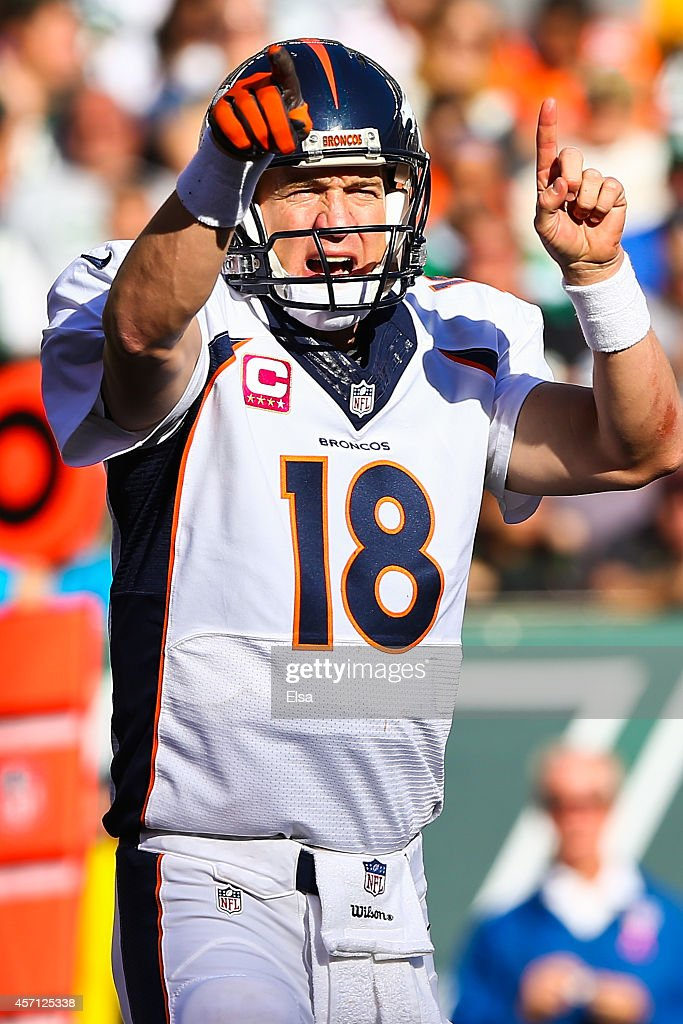 Peyton Manning #18 of the Denver Broncos yells to teammates in the third quarter during a game against the New York Jets at MetLife Stadium on October 12, 2014 in East Rutherford, New Jersey.